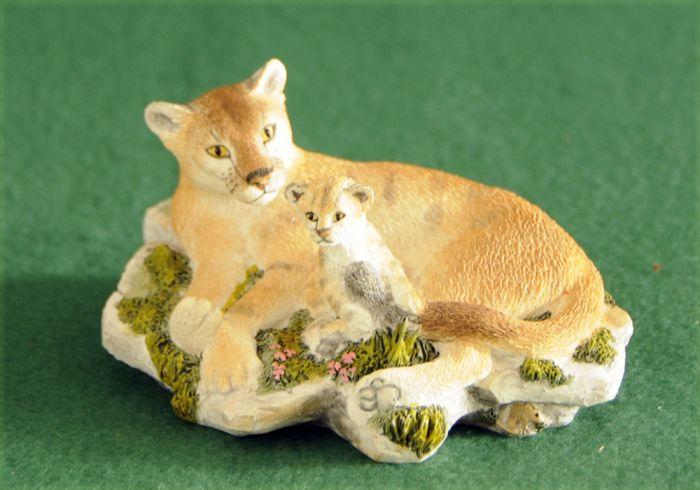 Mountain Lion And Kitten Sculpture.